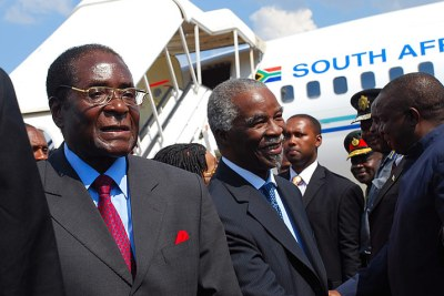 President of Zimbabwe Robert Mugabe and former South African president Thabo Mbeki (file photo).