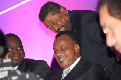 Ping shares a laugh with President Denis Nguesso of the Republic of Congo.