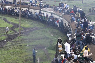 Nairobi commuters sit on top of a crowded an RVR passenger train (file photo).