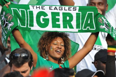 A Super Eagles fan displays her support.