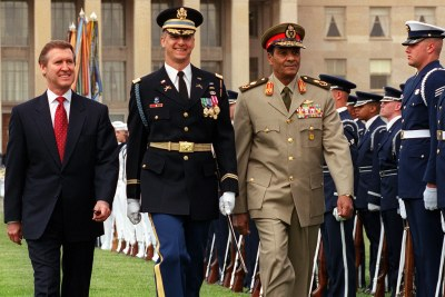 Former Minister of Defense of Egypt Field Marshal Mohamed Hussein Tantawi, right, is escorted by Commander of Troops Lt. Col. Mark Armstrong, U.S. Army, and Secretary of Defense William S. Cohen, left, as he inspects the joint service honor guard during a military full honor arrival ceremony at the Pentagon. (file photo)