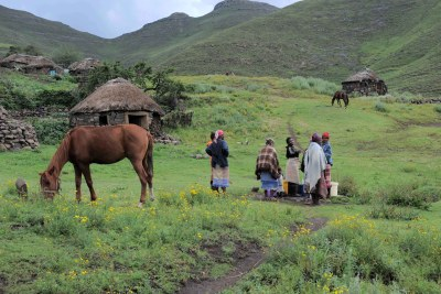 Women collect water from a communal tap in the village of Ha Rantismane in the mountains of Lesotho.