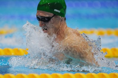 South Africa's Cameron van der Burgh wins Gold in the Men's 100 metre breaststroke.