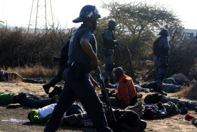 Police on the scene at Lonmin platinum mine in Marikana in the North West where ongoing violence resulted in the shooting of a number of people on Thursday, 16 August 2012.