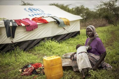 A Sudanese refugee and her daughter in Gendrassa camp, where one person has died of Hepatitis E.