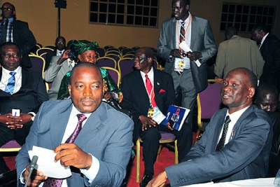 DRC President Joseph Kabila, left, with South Sudan minister of commerce and investments, Garanga Dung Akwang in Kampala.