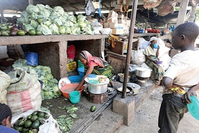Women vendors selling their agricultural produce at a Tanzanian market (file photo).