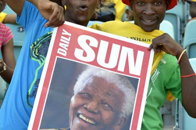 Nelson Mandela smiles during a meeting in Johannesburg in this file photo dated 2 June 2009. Mandela celebrates his 94th birthday on Wednesday.