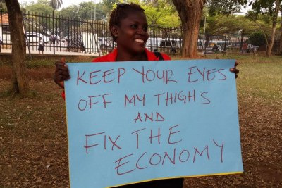 The Ugandan Women's Network organised a protest against harassment and attacks that have followed the signing of the Anti-Pornography Bill. Women, and some men, have been attacked for their attire - women for wearing mini-skirts and men for wearing sagging trousers.
