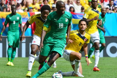 Yaya Toure evades a tackle from Carlos Sanchez of Colombia during their World Cup clash.