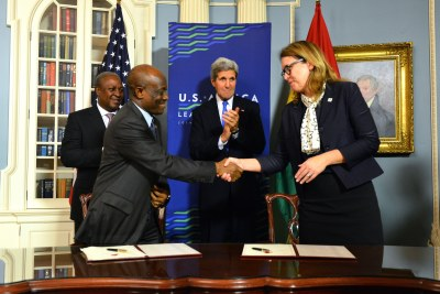 MCC CEO Hyde and Ghana's Finance Minister Terkper Shake Hands After Signing the Ghana Compact