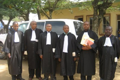 Wonga Okongo, President of the Grand Tribunal of Bunia, third from right, flanked by magistrates of the prosecution and defense in Bunia, DRC.