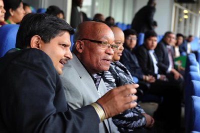 President Jacob Zuma, right, and Atul Gupta.