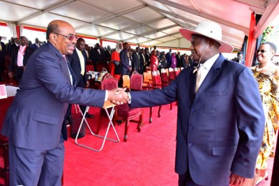 President Museveni (Right) greets Sudan's Omar-al-Bashir at the former's inauguration in Kampala.