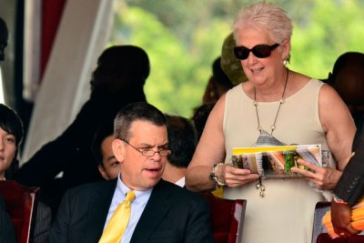 Mr Bruce Wharton (Left), the US Principle Assistant Secretary for African Affairs, chats with US Ambassador Deborah Malac during President Museveni's swearing-in ceremony at Kololo Independence Grounds in Kampala on Thursday.