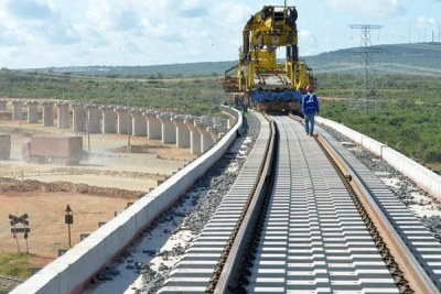 China Road and Bridge Corporation workers proceed with the construction of an overpass for the standard gauge railway, on May 25, 2016, in Taru (file photo).