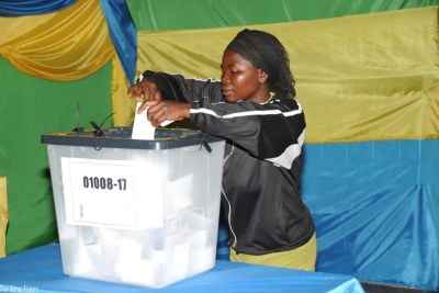 A voter in Kiyovu casts her vote during a local election (file photo).