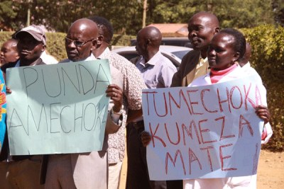 University Academic Staff Union's Moi University chapter officials and members demonstrating in Eldoret (file photo)