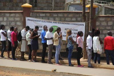 People queue to register as voters (file photo).