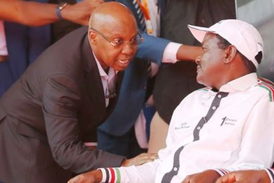 Businessman Jimi Wanjigi (left) talks to Nasa co-principal Kalonzo Musyoka during a rally at Uhuru Park (file photo).