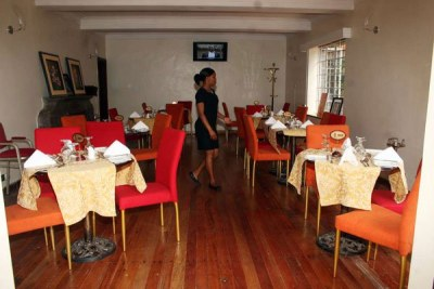 A waitress at the San Valencia Gardens restaurant in Lavington, Nairobi.