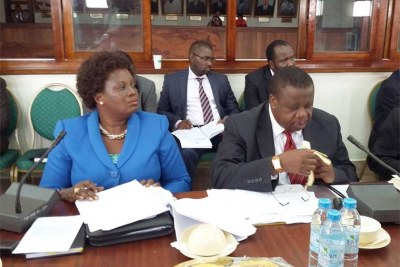 Ministers Kahinda Otafiire and Betty Amongi before the Legal and Parliamentary Affairs committee.