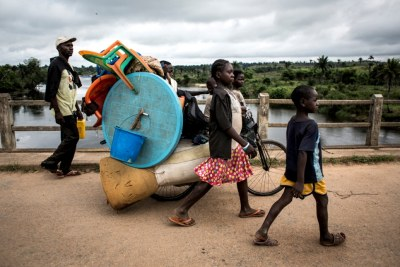 Congolese family fleeing ethnic violence in Kamonia, Kasai province