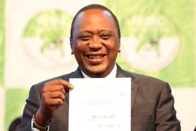 President Uhuru Kenyatta holds his certificate after he was announced winner of the repeat presidential election at the Bomas of Kenya in Nairobi October 30, 2017.