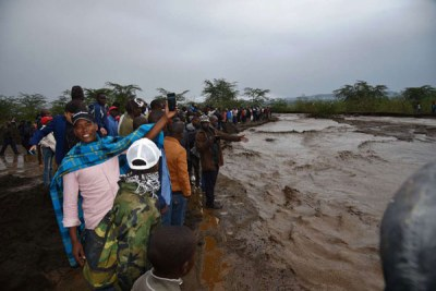 Motorists watch the raging water that cut off Narok-Mai Mahiu road in Suswa area on April 15, 2018.