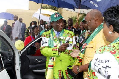 President Mnangagwa hands over keys to one of the vehicles bought for the election campaign to Manicaland provincial chairman Mike Madiro after the launch of the party's election manifesto in Harare. Looking on is First Lady Auxilia Mnangagwa