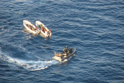Pirate suspects, left, being seized by European naval forces off the coast of Somalia.