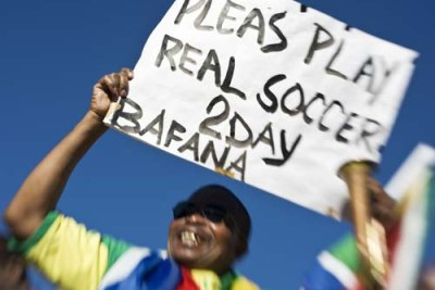 A South African fan exhorts his team