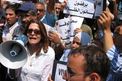"An anti-corruption demonstration in Cairo in 2006. Some of the placards read ""Silence the press..."" and ""Long live corruption""."