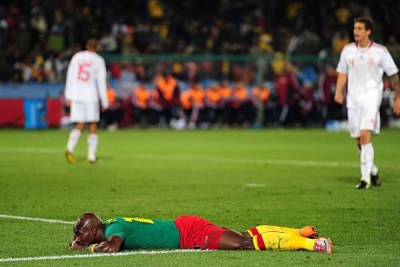 Cameroon's Achille Emana lies dejected after missing a chance to scored.
