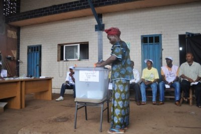 A woman casts her ballot (file photo).