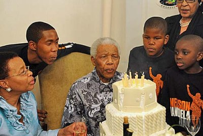 Nelson Mandela celebrated his birthday with his family, including his wife, Graca Machel, left, and former wife, Winnie Madikizela-Mandela, top right.