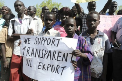 South Sudanese citizens show support for their government's decision  to shut down all national oil production, effectively cutting off the flow of crude oil from South Sudan to Sudan.