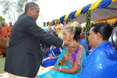 Princess Komuntale with her fiance in a traditional wedding.