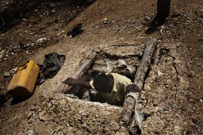 An artisanal gold miner descends into a pit (file photo).