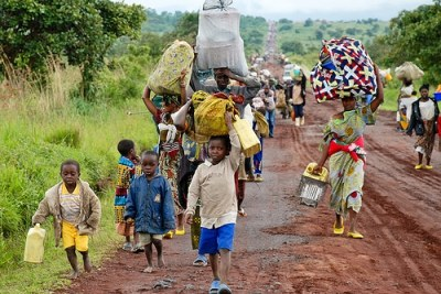 In the Eastern Democratic Republic of Congo, thousands of internally displaced people walk along the main road from Rumang'abo to Goma, fleeing the Kibumba region where fighting is ongoing.