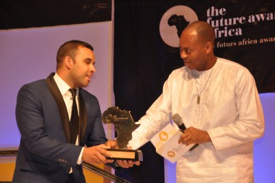 """R-L: Dr. Yinka Adedeji, Divisional Head, E-Banking, UBA Plc presenting an Award to Samir Ibrahim, Co-Founder of SunCulture, Kenya, winner """"the Future Africa Awards Prize in Agriculture,"""" at the Future Awards ceremony in Lagos recently"""