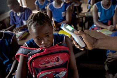 As children in Sierra Leone finally resumed classes almost nine months after the Ebola outbreak, they were greeted by teachers carrying digital thermometers.