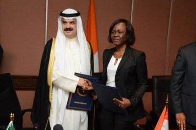 Hamad Al-Omar (Directeur général adjoint du Fonds koweïtien) et Nialé Kaba (Ministre ivoirien délégué à l'Economie)