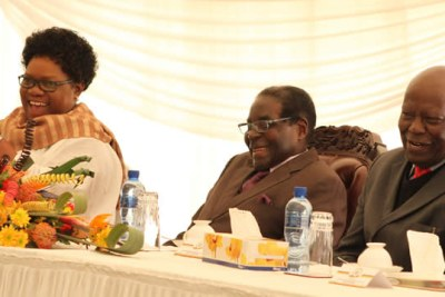 Robert Mugabe flanked by Joice Mujuru and Didymus Mutasa share a lighter moment during happier times.