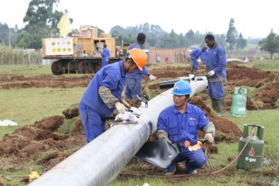 Workers put final touches on the Western Kenya Pipeline Extension Project (file photo).