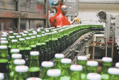 Technicians inspect beer bottles on a conveyor belt at Bralirwa's brewery in Gisenyi, Western Rwanda (file photo).