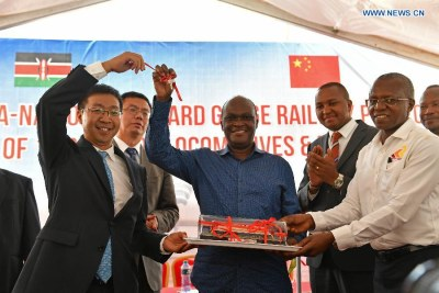 Kenyan Minister for Transport and Infrastructure James Macharia (C) and the Managing Director of the Kenya Railways Corporation Atanas Maina (R, front) attend the reception ceremony of the first batch of locomotives for the Mombasa-Nairobi standard gauge railway in Mombasa (file photo).