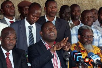 Sitting, from left: Universities Academic Staff Union secretary-general Constantine Wasonga, Kenya Universities Staff Union secretary-general Charles Mukhwaya and UASU chairman Muga K'Olale at Chester House in Nairobi.