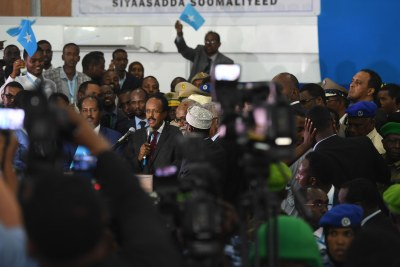 President of Somalia, Mohamed Abdullahi Farmajo (centre) makes an acceptance speech after he was sworn into office at the Mogadishu Airport hangar on February 8, 2017.