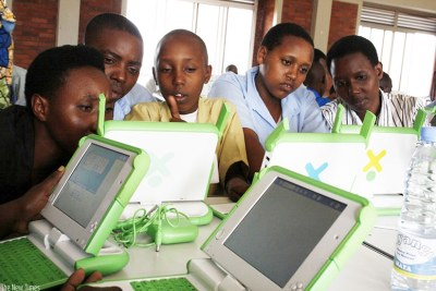 Pupils of Kimisagara Primary School use their laptops acquired under the One-Laptop-Per-Child project (file photo).